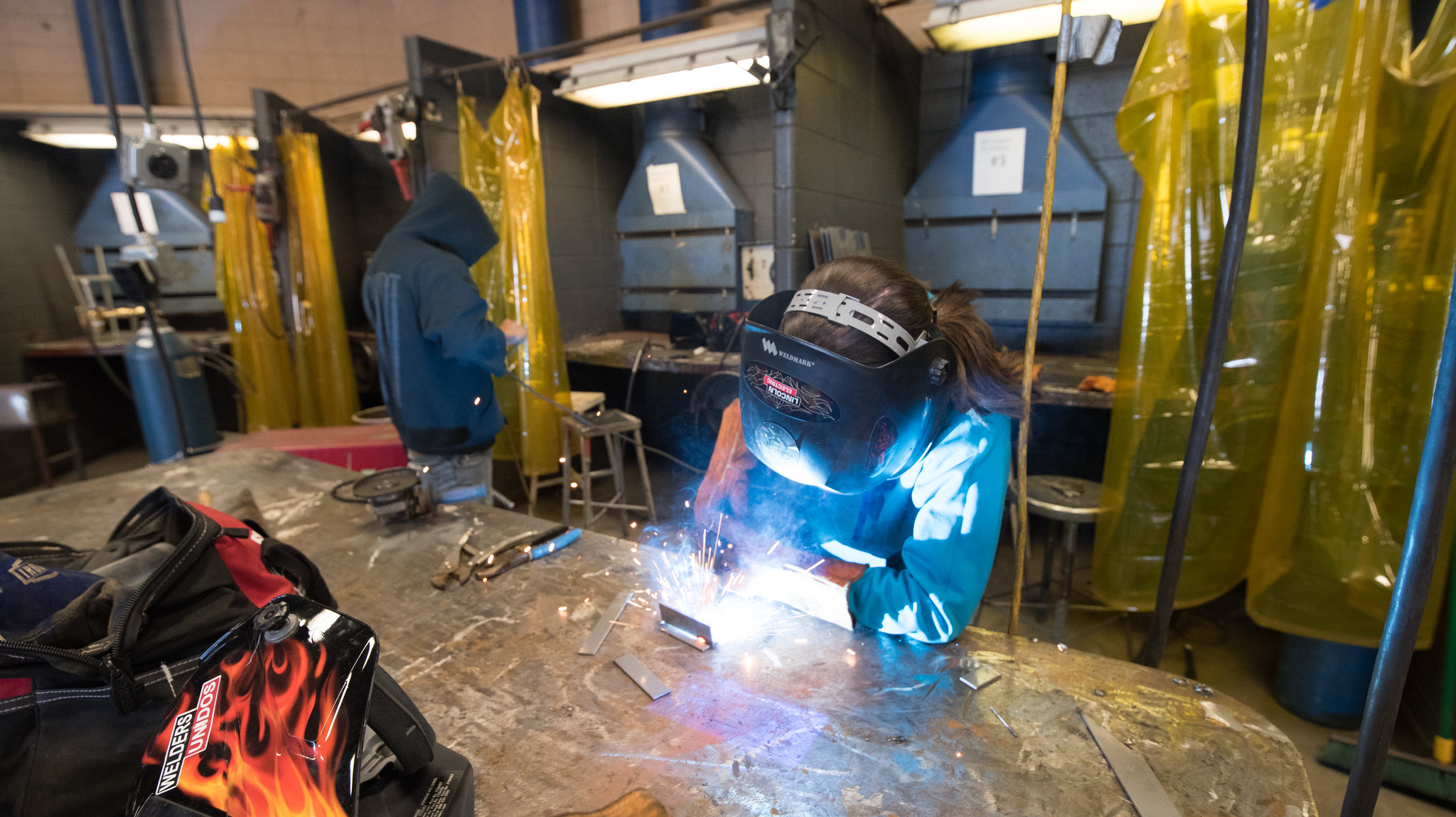 student in a welding class
